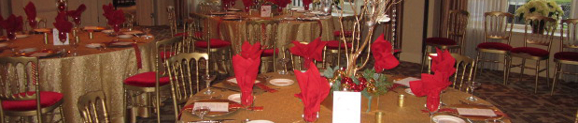 Red napkins on a table with gold cloth.